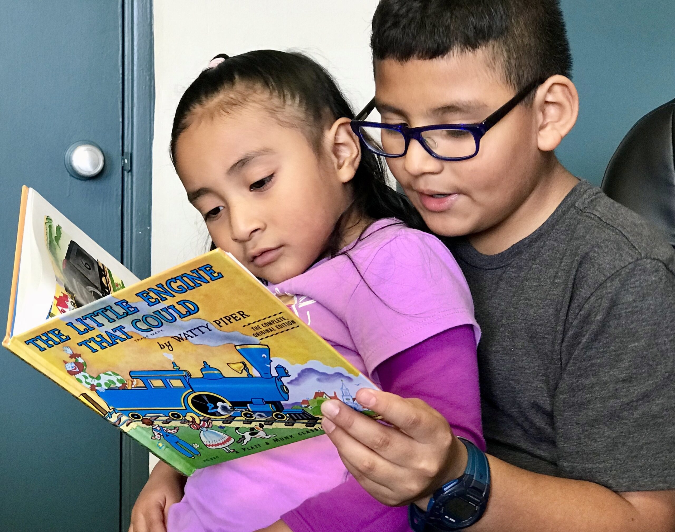 """Brother and sister reading """"Little Engine That Could"""""""